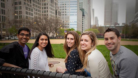 Students sitting on a bench on the Chicago campus
