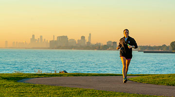 Girl running by the lake front